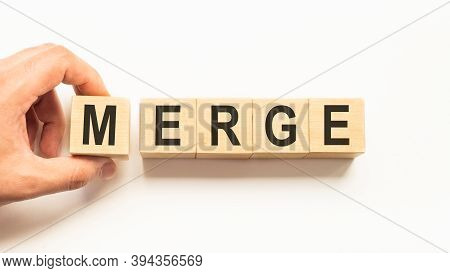 Word Merge. Wooden Small Cubes With Letters Isolated On White Background With Copy Space Available.b