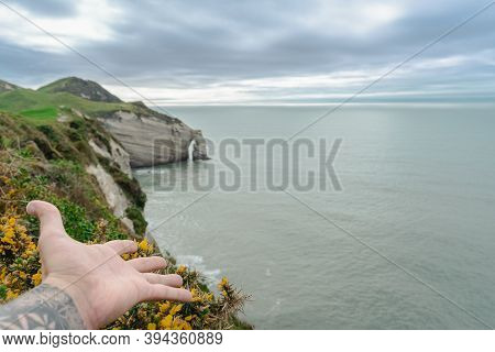 Man Hand Showing Cape Farewell, New Zealand Landscape.
