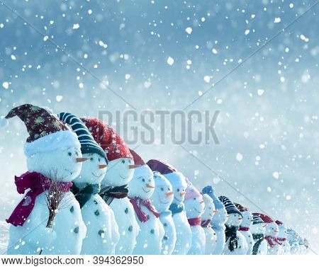 Happy New Year greeting card with copy-space.Many snowmen standing in  Christmas landscape.Winter background