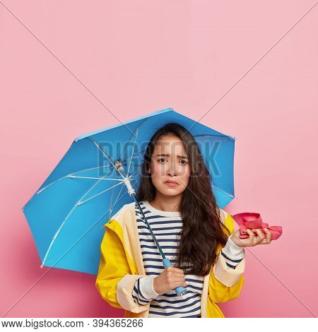 Photo Of Displeased Korean Woman Holds Handkerchief, Caught Cold During Cold Rainy Weather, Has Runn