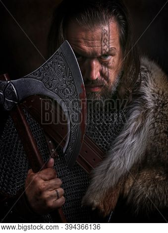 Close Up Portrait Of Viking With Axe