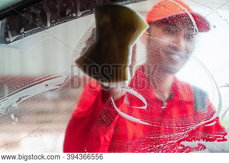 Image Photo Of A Car Cleaning Man Wearing A Uniform Cleaning The Side Glass With A Foamy Sponge
