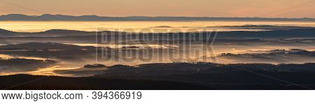 Landscape Panorama With Light Rays From Rising Sun Peaking Through Morning Mist During Inversion, Je