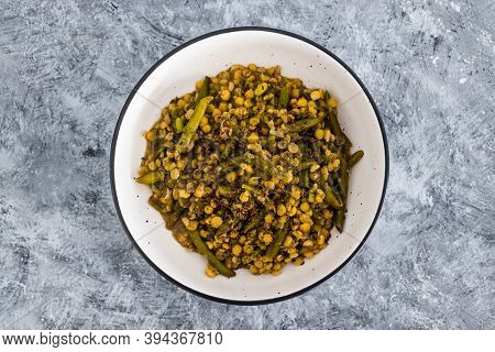 Plant-based Food, Vegan Curry With Yellow Split Peas Green Beans And Onions Topped With Flax Seeds