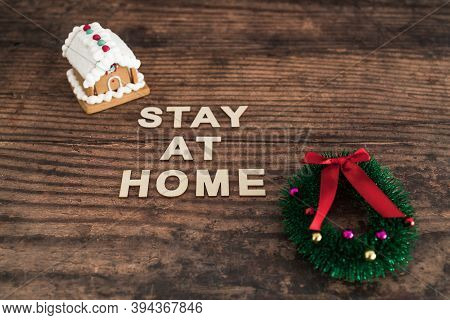 Holidays In Lockdown Due To Covid Conceptual Image, Mini Decorative Christmas Gingerbread House  And