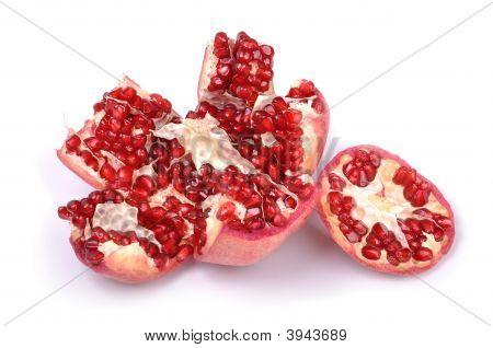 Broken Pomegranate On White