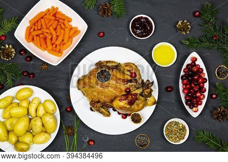 Christmas Dinner, Top View. Traditional Roasted Chicken, Vegetables And Seasoning Decoration On Blac