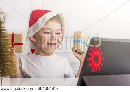 Kid Boy 5-6 Years Celebrates Christmas During Quarantine. Virtual Party Online With Friend Or Grandp
