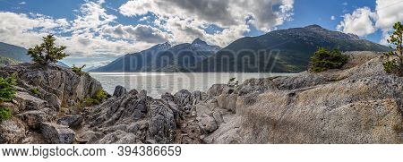 Panoramic Shot From Yucatania Point Near Skagway, Alaska. Rocky Terrain As A Foreground. Mountains A