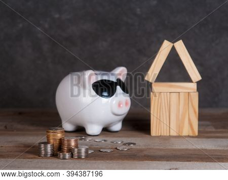 Rise In The Real Estate Market. Piggy Bank With Coins