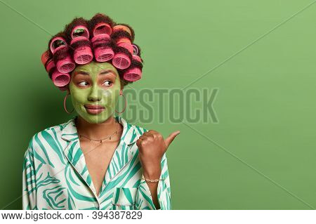 Young Lady Gives Tipes How To Look Young And Beautiful, Points Thumb Away On Blank Space, Grooming W