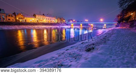 Uzhhorod, Ukraine - 26 Dec, 2016: Old Town On A Christmas Night. Beautiful Cityscape By The River. S