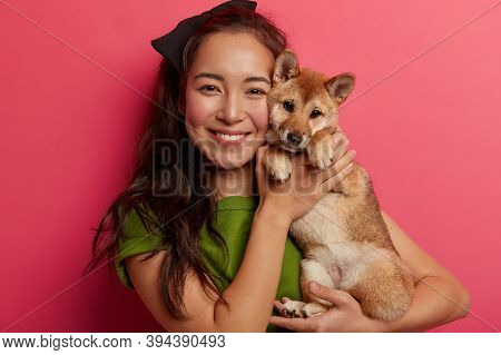 Caring Female Host Poses With Pedigree Cute Dog, Glad To Buy Puppy, Likes Spending Free Time With Do