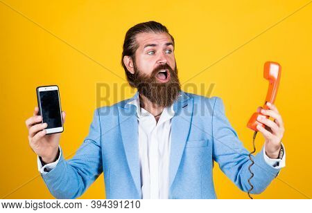 Life Meets Possibilities. Mature Bearded Man With Retro Phone. Male Hold Smartphone. Compare Technol