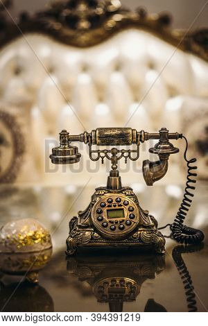 Antique Vintage Rotary Old Hang Up Telephone Model With Beautifully Embossed Gold Bronze Texture In