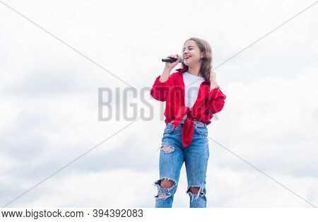 Having A Party. Happy Kid With Microphone. Karaoke Concept. Singing Songs. Lifestyle And People Conc