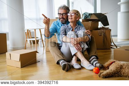 Portrait Of Happy Senior Couple In Love Moving In New Home