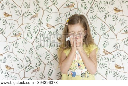 A Nice Little Girl Sneezes Into A Handkerchief Because She Has A Seasonal Allergy To Pollen And Flow