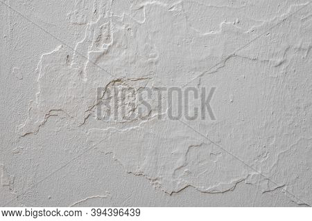 Gray White Rough Abstract Stucco Texture For Background. Texture Of The Gray Stucco. Abstract Concre