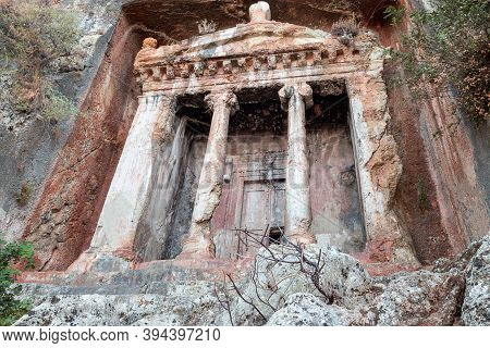 Tomb Of Amyntas, Also Known As The Fethiye Tomb. View Of The Tombs Carved Into The Rock From The Tim