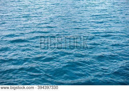 Clear Blue Ocean Water. Backgrounds Of Water From The Ocean. Wave On The Surface Background Texture