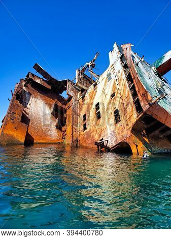 Shipwreck Of A Tanker That Ran Aground Off The Coast Of Crimea, Russia, 100 Meters From The Shore.