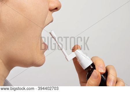 A Man Sprays A Coughing Agent Into His Throat - An Antiseptic Against Laryngitis And Pharyngitis. Me