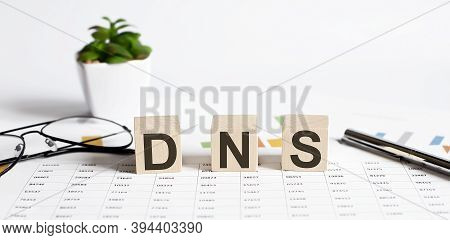 Dns - Acronym Domain Name System Concept On The Cubes