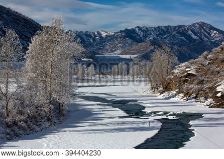Fabulous Winter Landscape On The River. Trees In Hoarfrost. Bright Winter Sunny Day. Mountains In Th