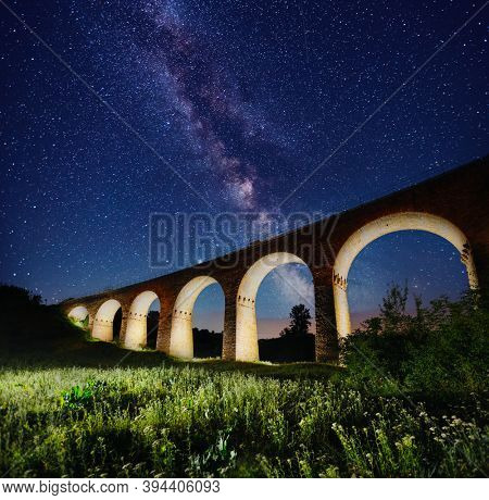 Fantastic starry sky over the old viaduct. Location village of Plabanivka, Ukraine, Europe. Popular european tourist place. Long exposure shot, astrophotography. Discover the beauty of earth.