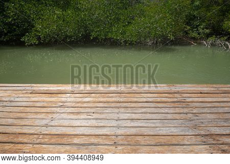 Wooden Pier With View To Tropical Water At Mangrove Forest