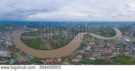 Aerial View Of Buildings With Curve Of Chao Phraya River. Cha Choeng Sao Skyline Near Bangkok, Urban
