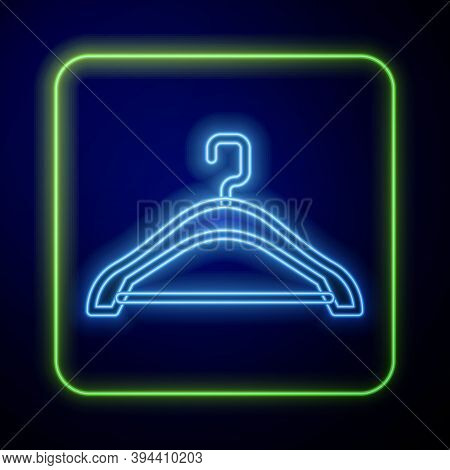 Glowing Neon Hanger Wardrobe Icon Isolated On Blue Background. Cloakroom Icon. Clothes Service Symbo