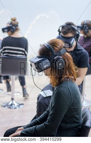 People Sit In 3d Virtual Reality Glasses Oculus Rift Gear Vr. Exhibition Days Of The Far East - Mosc