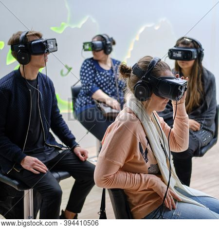 Men And Women Wearing Oculus Rift Gear Vr Virtual Reality Helmet - Moscow, Russia, 12 13 2019