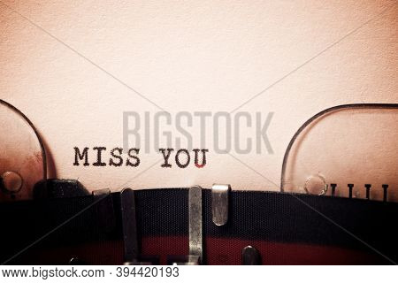 Miss you phrase written with a typewriter.