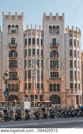 Barcelona, Spain - Feb 24, 2020: Edifice On Street Via Laietana Near Plaza Catalunya