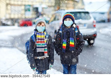Two Kids Boys Wearing Medical Mask On The Way To School. Children With Backpack Satchel. Schoolkids