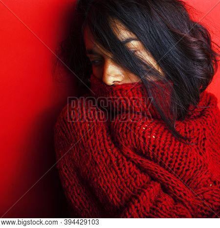 Young Pretty Indian Girl In Red Sweater Posing Emotional, Fashion Hipster Teenage, Lifestyle People