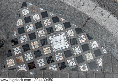 Barcelona, Spain - Feb 24, 2020: Memorial Plaque Of Qaui Yace Un Bache On The Steet Near Plaza Catal
