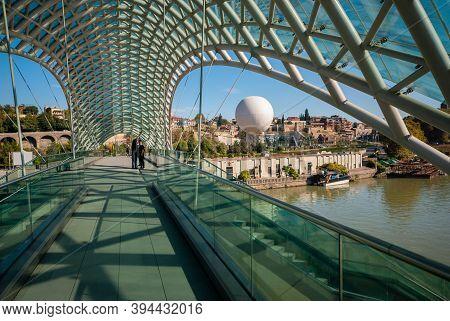 Georgia, Tbilisi - October 23, 2020: Bridge Of Peace Over The Kura River In Tbilisi , Georgia.