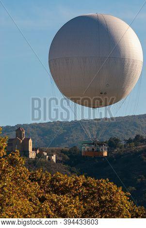 Georgia, Tbilisi - October 24, 2020: Air Excursion Balloon Over Tbilisi, Capital Of Georgia.