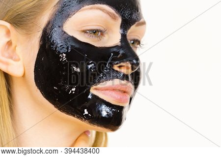 Woman With Black Peel Off Mask On Face