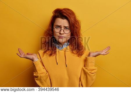 Charming Dissatisfied Redhead Woman Has No Knowledge, Makes Hard Solution, Spreads Palms, Cant Choos
