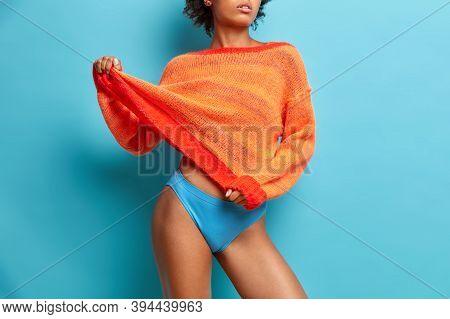 Image Of Slim Female Model With Slender Legs Wears Loose Jumper Blue Panties Has Healthy Smooth Skin