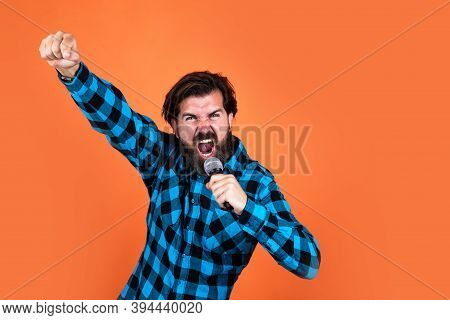 Be Louder. Bearded Hipster Sing A Song In Microphone. Guy With Mic. Concept Of Music. Singing Man We