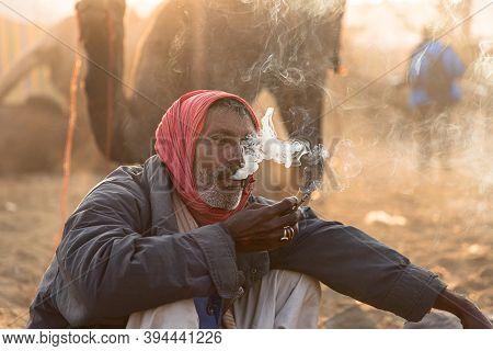 November 2019 Pushkar,rajasthan:portrait Of A Man Is Smoking Bidi At Pushkar Festival,india.