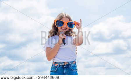 Child Singing Outdoor. Singer With Microphone. Happy Childhood. Happy Girl Enjoy The Moment. Have Fu