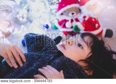 Kid Lying On Carpet Watching Tv With Blurry Bright Light Christmas Decorations Background, A Happy C