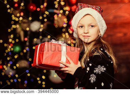 Winter Shopping. Girl Cute Child Hold Wrapped Gift Near Christmas Tree. Holiday Party That Actually